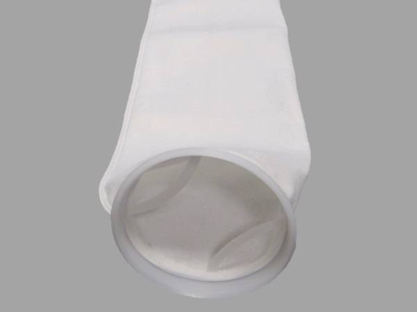 A piece of white color polyester filter bag on gray background.
