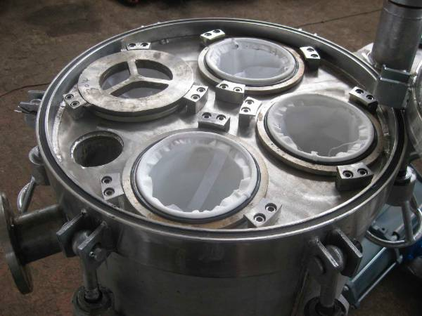 A polyester filter bag is installed in the bag filter housing.