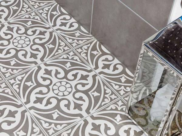 Several ceramic tiles are paved on the floor.
