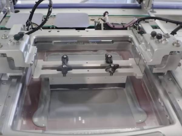A machine is screen printing crystalline solar cell.