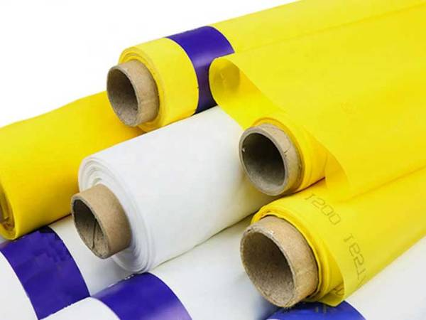 Several yellow and a white screen printing mesh on gray background.